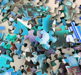 Lots of jigsaw pieces - unsplash image by hans peter gauster